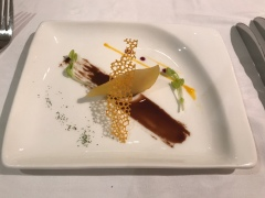 A complimentary dish consisting of roasted pear